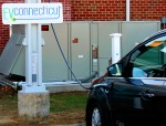 Automobile charging at new Coventry charging station at Town Hall.